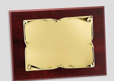placa homenaje dorada